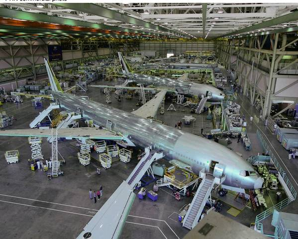 Boeing employees at a plant in Everett, Wash., work on the companys 777-300 before the aerospace giant made its first delivery of the airliner in 1998.