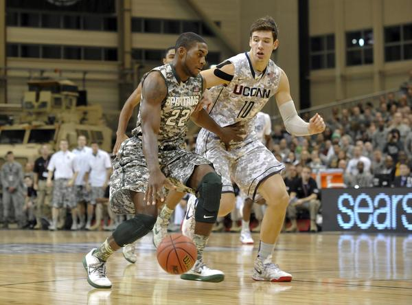 Nov 9, 2012; Ramstein, GERMANY; Michigan State Spartans guard Branden Dawson (22) drives past Connecticut Huskies forward Tyler Olander during the game at Ramstein Air Base. Mandatory Credit: Martin Goldhahn/View via US PRESSWIRE ORG XMIT: USPW