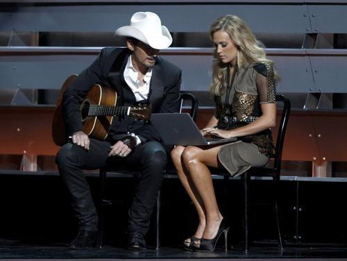 Co-hosts Brad Paisley, left, and Carrie Underwood perform a skit during the opening of the 47th CMA Awards.