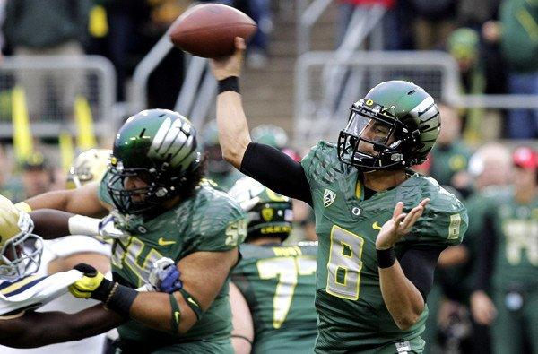 Ducks quarterback Marcus Mariota is a dual-threat quarterback with speed to burn and an accurate passing touch.