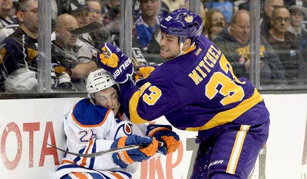 Kings defenseman Willie Mitchell puts Edmonton's Mark Arcobello into the boards with a check during L.A.'s 2-1 win over the Oilers on Sunday.