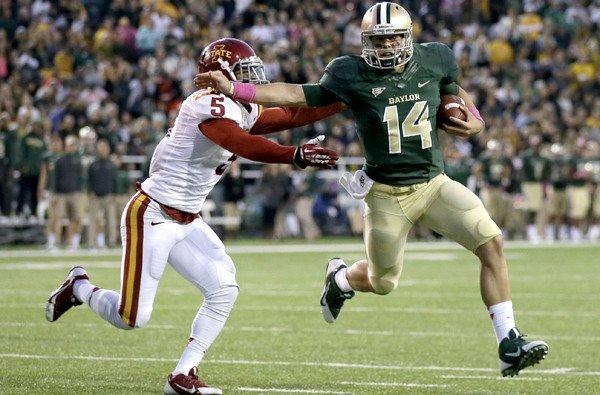 Baylor quarterback Bryce Petty (14) tries to elude Iowa State defensive back Jacques Washington during a game last month. Petty has led the Bears to an 8-0 record this season.