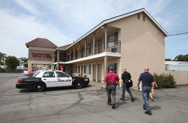 A team of code enforcement officers and county health department inspectors check on conditions at the Sandpiper Motel in Costa Mesa with help from the Costa Mesa PD.