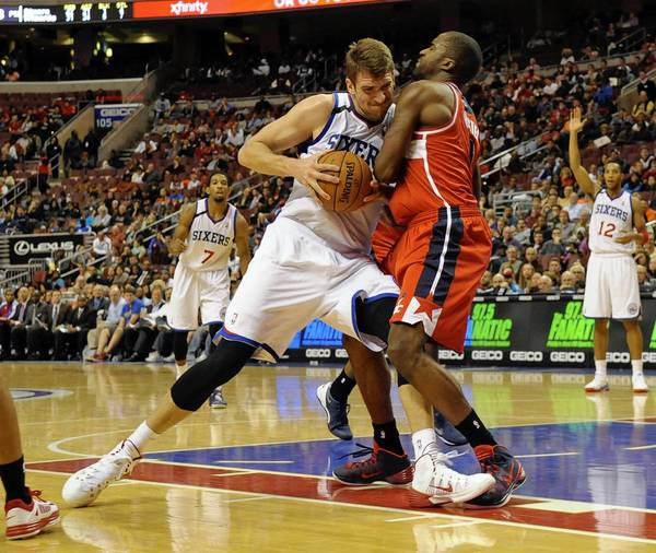 76ers center Spencer Hawes (00) is called for a charging foul against Washington's Martell Webster on Wednesday night.