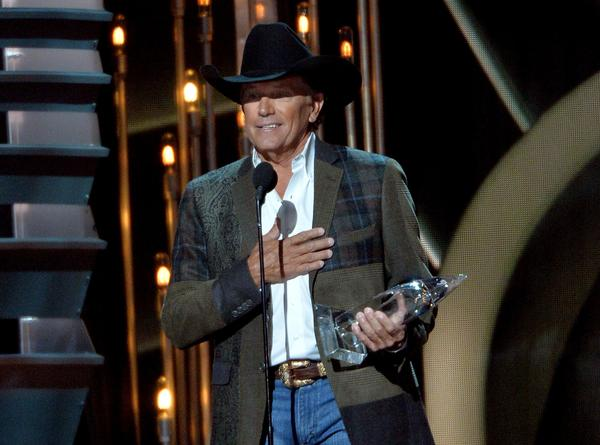 Entertainer of the year winner George Strait speaks during the 47th annual CMA Awards at the Bridgestone Arena in Nashville.