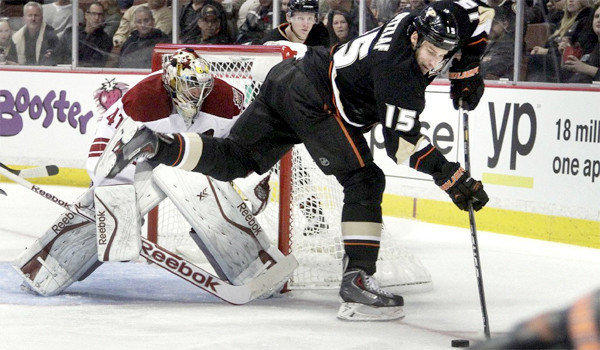 Ducks center Ryan Getzlaf backhands a puck in front of Coyotes goalie Mike Smith during Anaheim's 5-2 win over Phoenix at the Honda Center on Wednesday. Getzlaf scored his seventh goal of the season against Smith in the second period.