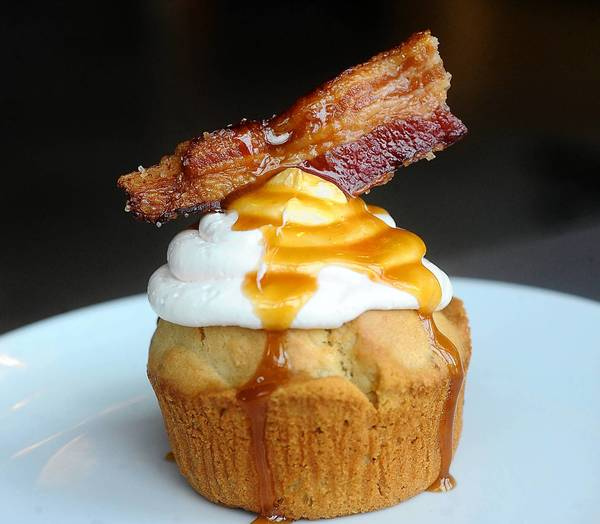 A bacon cupcake with salted caramel icing is one of many bacon treats at Bacontopia at ArtsQuest Center at SteelStacks in Bethlehem Nov. 10.
