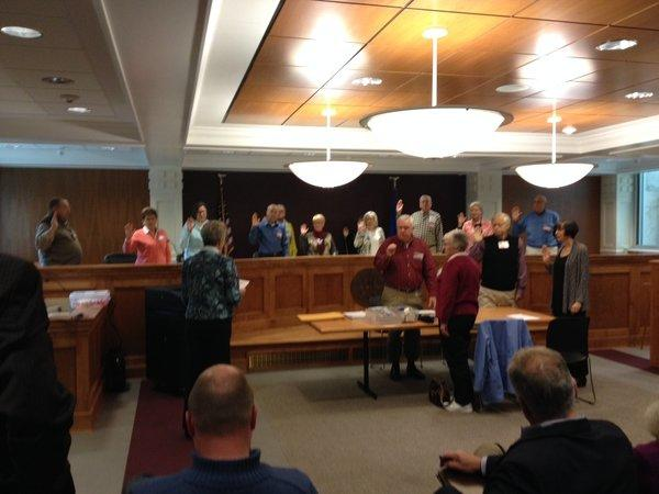 Election officials are sworn in for a recount in the Farmington board of education race on Thursday morning.