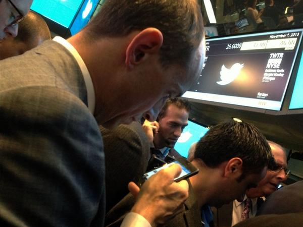 Twitter CEO Dick Costolo tweets as he waits for stocks to open at the New York Stock Exchange.