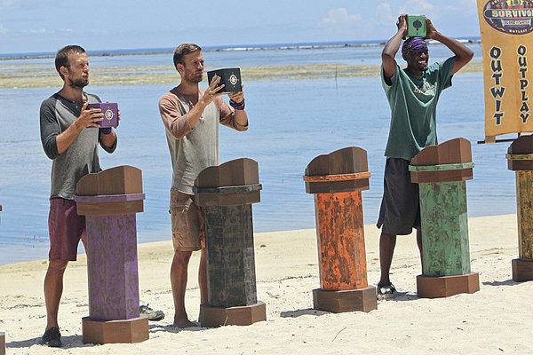 L-R: Vytas Baskauskas, Aras Baskauskas and Gervase Peterson compete in an Immunity Challenge.
