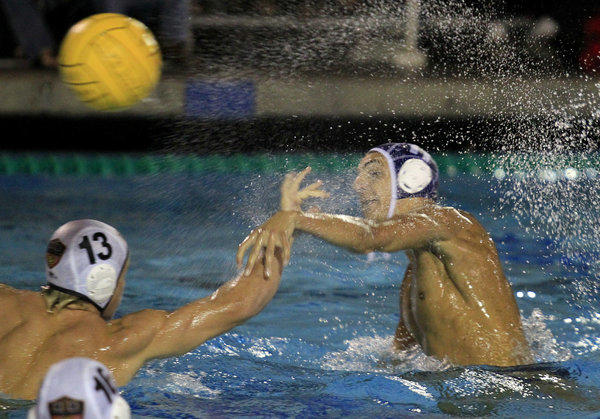 Newport Harbor High's Mitchell Mendoza, right, scores on Huntington Beach's Gavin Wuerfel (13) during the first half in a Sunset League match on Wednesday in Newport Beach.