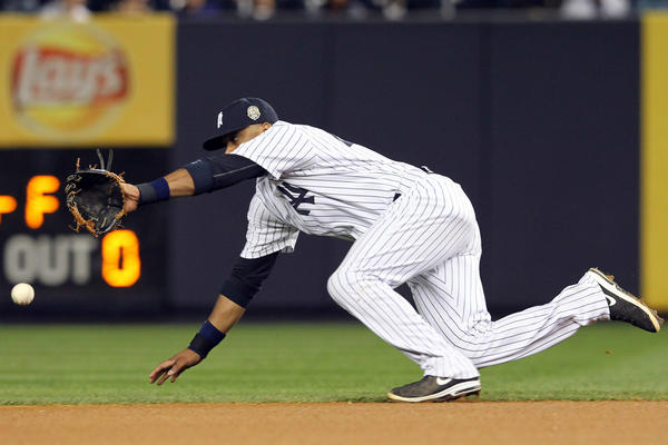 New York Yankees second baseman Robinson Cano cannot field a single hit by Tampa Bay Rays right fielder Wil Myers during the fourth inning of a game at Yankee Stadium.