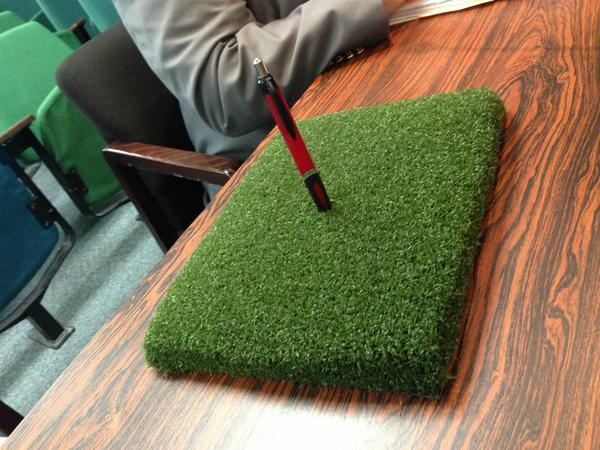 A sample of the new artificial turf being installed at the Allentown Municipal Golf Course's driving range is showcased at an Allentown City Council meeting earlier this year. The new turf can support wood tees.