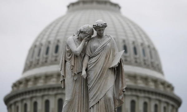 The statue of Grief and History is pictured in front of the U.S. Capitol Dome in Washington