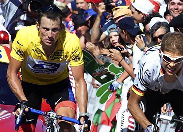 File picture of Lance Armstrong (L) climbing up to Luz-Ardiden, France in the Tour de France.