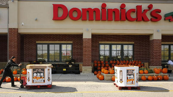 Employee Casimiro Delgado brings pumpkins out for display at the Dominick's in Glenview last month.