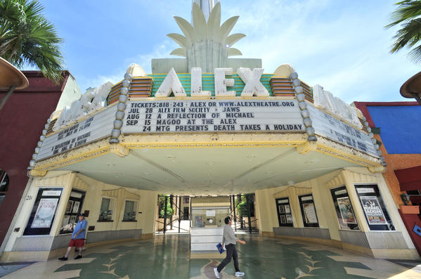 Pedestrians walk past the Alex Theatre on Tuesday, July 10, 2012.