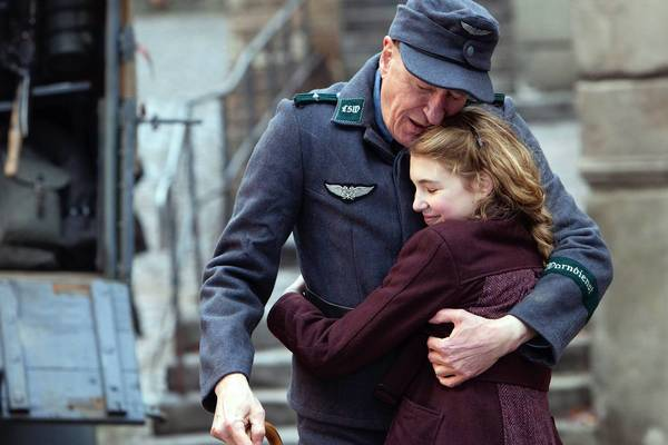 "Sophie Nelisse and Geoffrey Rush star in ""The Book Thief."""