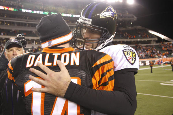 Bengals quarterback Andy Dalton and Ravens quarterback Joe Flacco embrace after a game in 2012.