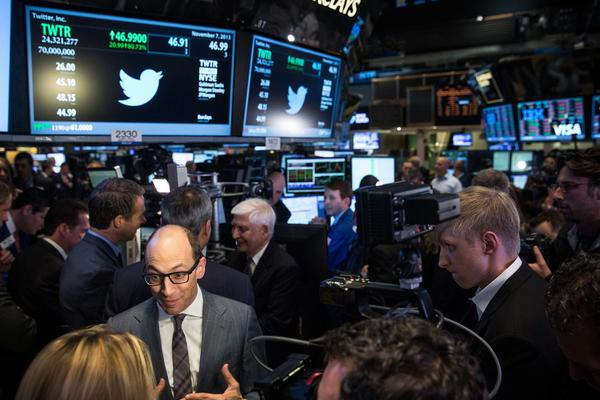 Twitter CEO Dick Costolo is interviewed by a broadcaster reporter after Twitter's IPO on the floor of the New York Stock Exchange (NYSE) on November 7, 2013 in New York City. Twitter went public November 7, on the NYSE selling at a market price of $45.10, with the initial price being set at $26 on November 6.