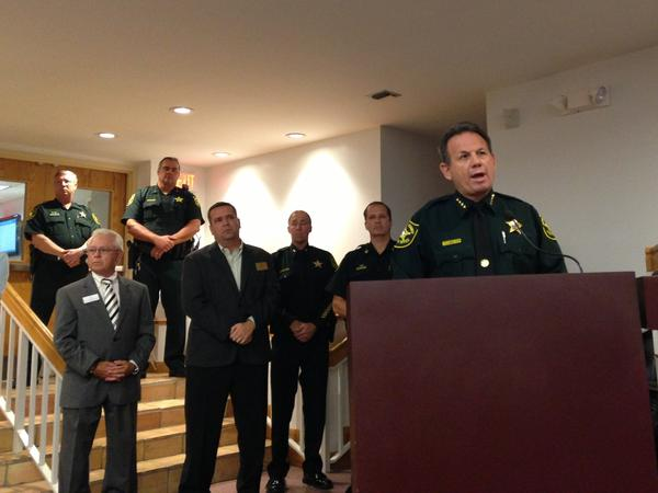 Broward Sheriff Scott Israel announces the arrest Thursday of a suspect in a double homicide.