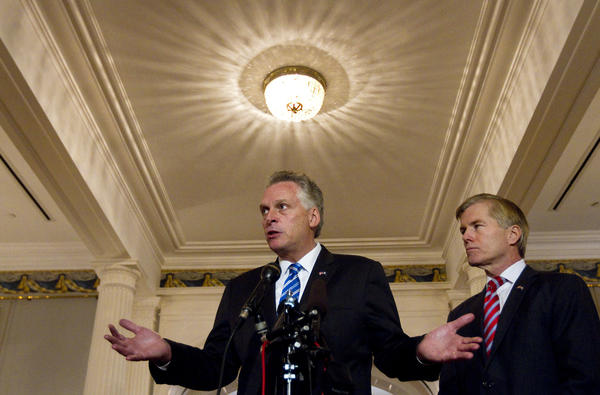 Governor-Elect Terry McAuliffe and Governor Bob McDonnell hold a press conference inside the Executive Mansion on Thursday in Richmond.