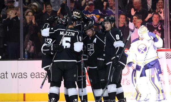 The Kings celebrate a power-play goal by Mike Richards during the first period of the team's 2-0 win over the Buffalo Sabres at Staples Center on Thursday.