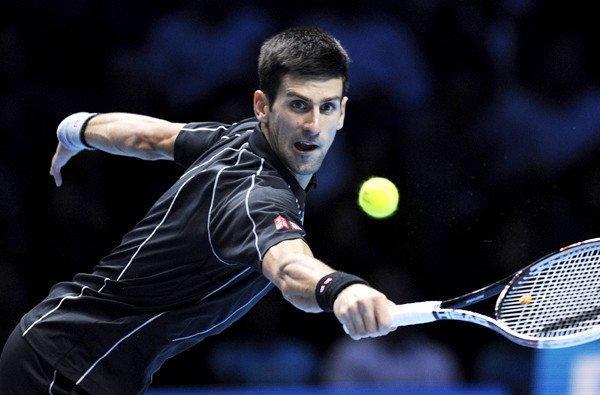 Novak Djokovic reaches to return a shot against Juan Martin del Potro on Thursday night.