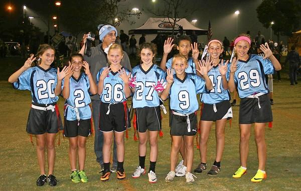 The North Carolina Tar Heels, coached by Dean Valeriano, went 8-0 in the fifth- and sixth-grade division during the regular season of the Friday Night Lights flag football league.