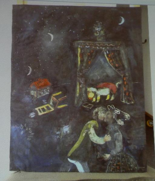 A formerly unknown painting of French artist Marc Chagall is beamed to a wall November 5, 2013, at an Augsburg courtroom during a news conference of state prosecutor Reinhard Nemetz and expert art historian Meike Hoffmann from the Berlin Free University.