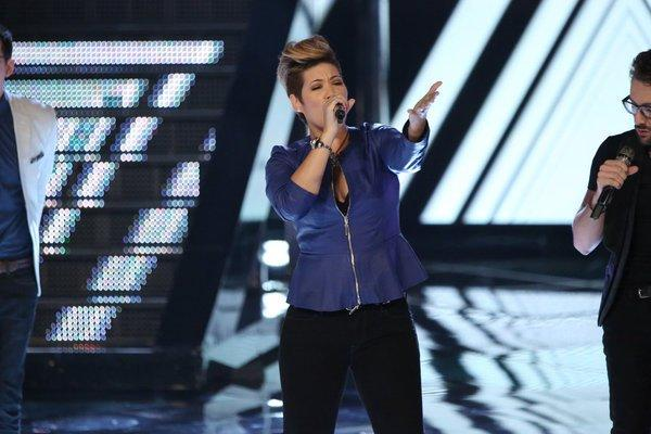 "Tessanne Chin performs on ""The Voice."""