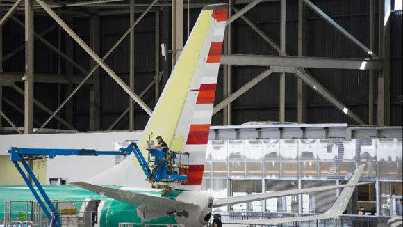 A technician works on the tail of an American Airlines 737 jet in production at Boeing's Renton, Wash., factory in April.