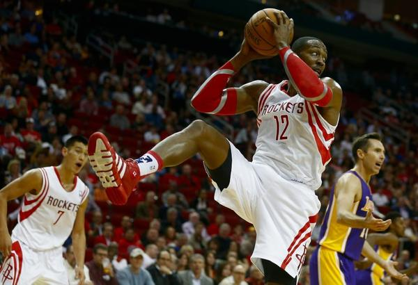 Houston Rockets center Dwight Howard grabs a rebound against the Lakers on Thursday.