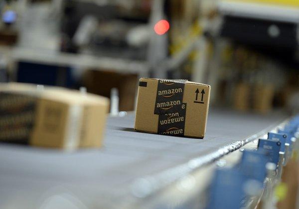 Shipping orders go by on a conveyor belt at Amazon's San Bernardino Fulfillment Center.