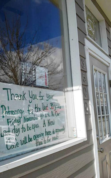A sign n the window announces that Roland Park Bakery and Deli would be closing Friday, Nov. 8.