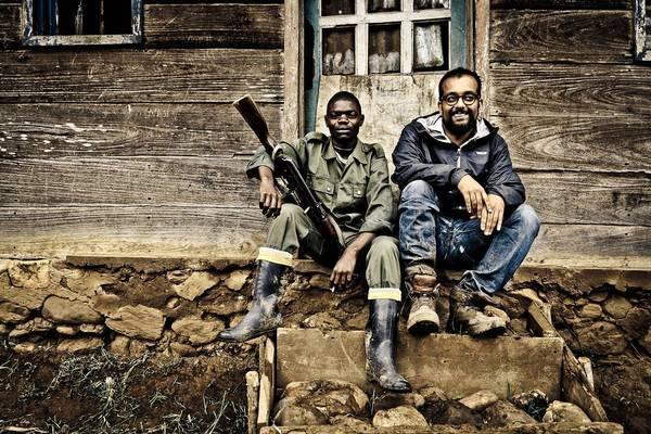 Suroosh Alvi, right, on location in Democratic Republic of Congo, at a Mai Mai camp, east of Goma.