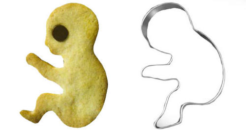 several small cookies and a cookie cutter, all shaped like a fetus. the cookies have chocolate chips for eyes