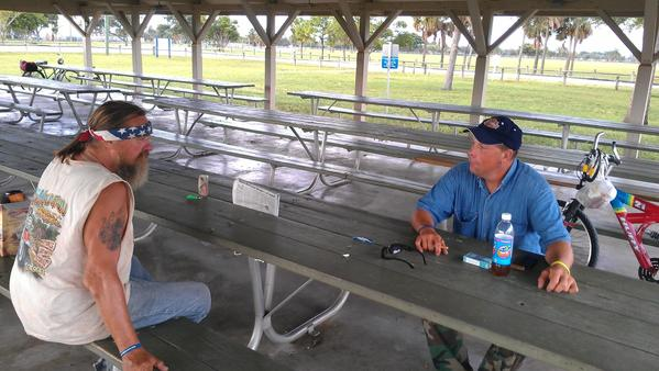 Jack McPherson and Kris Schuddekopf sit at one of the pavilions at John Prince Park near Lake Worth where they say tougher enforcement of park facilities rules are targeting the homeless