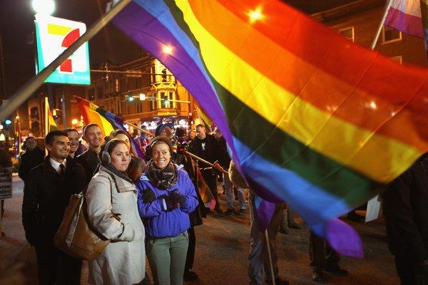 Supporters of same-sex marriage celebrate in Chicago after the Illinois General Assembly passed a gay marriage bill on November 7. Four same-sex couples in Idaho are suing in that state over the right to marry.