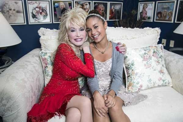 "Dolly Parton, left, judges a singing competition in ""A Country Christmas Story."" With Desiree Ross."