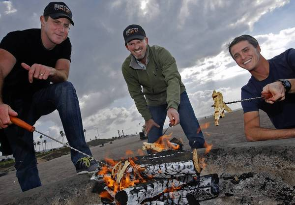 Beyond Meat's Ethan Brown, left, Tony Prudhomme and Brent Taylor cook the company's fake chicken over a fire near the firm's headquarters in El Segundo. The product, made from soy and pea protein, has attracted the attention of tech power investors such as Bill Gates.