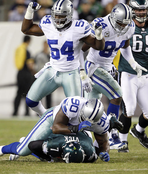 Former Dallas Cowboy Jay Ratliff (90) tackles Michael Vick in 2012.