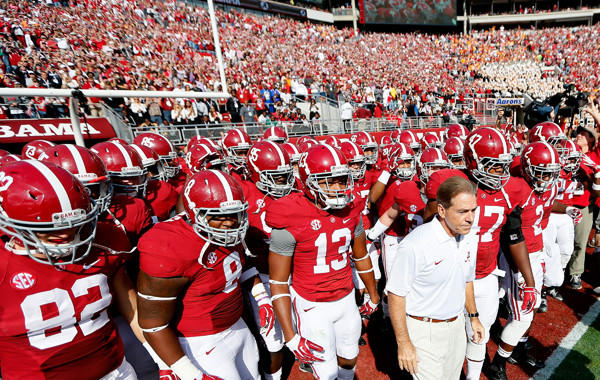 Alabama Coach Nick Saban leads his players onto the field before their Oct. 26 win over Tennessee. This year's Alabama-LSU showdown isn't drawing as much hype as previous editions of the rivalry, but it's still a big game.