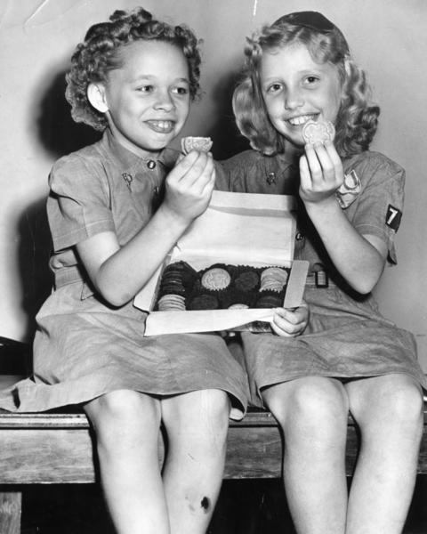 Girl Scouts sample cookies in this 1949 file photo.