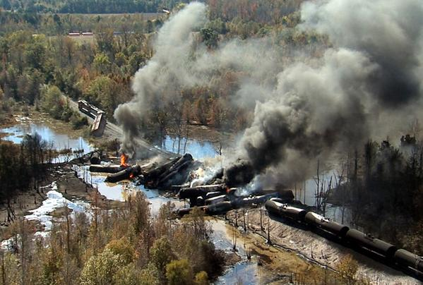 Smoke rises from a number of cars that derailed and exploded from a train carrying crude oil in Aliceville, Alabama.
