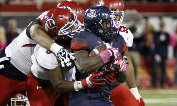 Arizona running back Ka'Deem Carey is tackled during a win over Utah last month. Stopping Carey will be a priority for the UCLA defense Saturday.