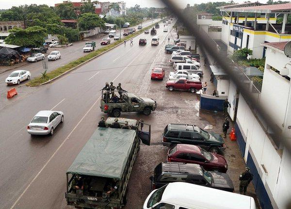 Troops of the Mexican army take over the port of Lazaro Cardenas and also the headquarters of the municipal police in Michoacan state, Mexico.