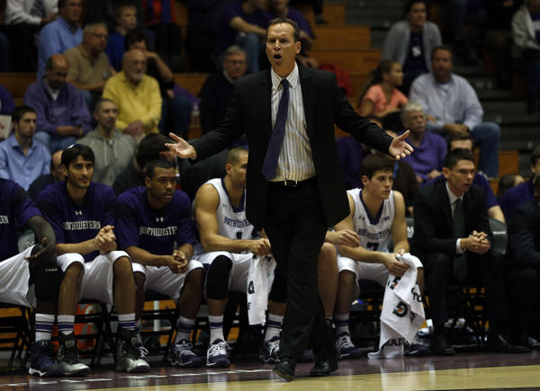 Northwestern coach Chris Collins complains about a non-call during the first half of a preseason game.