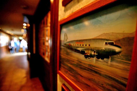 Photographs chronicling the history of aviation line the halls of the Proud Bird restaurant in Los Angeles. Located beside the southernmost runway of LAX, the landmark eatery is scheduled to close.