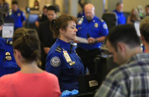 Transportation Security Administration employees observe a moment of silence on Friday at 9:20 a.m., the same time of last Friday's shooting that left TSA Officer Gerardo Hernandez dead.
